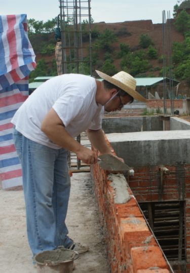 Jimmy building a wall in China