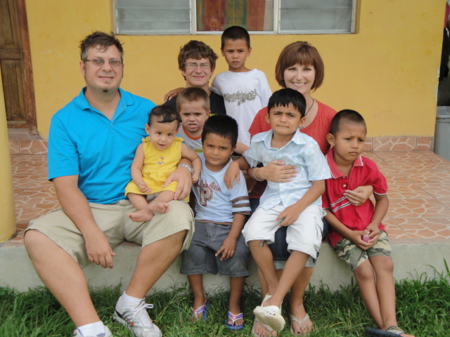 Jimmy, DeAnna and Taylor with children at an orphanage in Tocoa, Honduras.